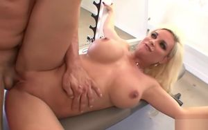 Huge-titted blond gets poked at the gym